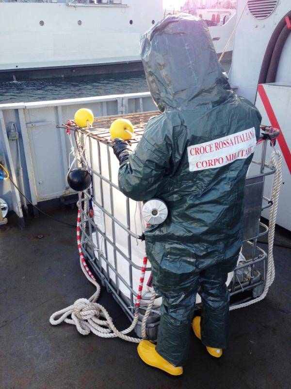 "FIG.2. ""Tremiti"" Italian Navy Vessel, ItRC MC Operator / Protection recommended measures in biocontainment environment – Tyvek suit and PAPR - rear view."